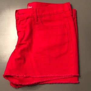 Red denim cutoff shorts